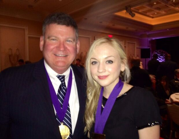 File:Emily with a medal with an old man.jpg