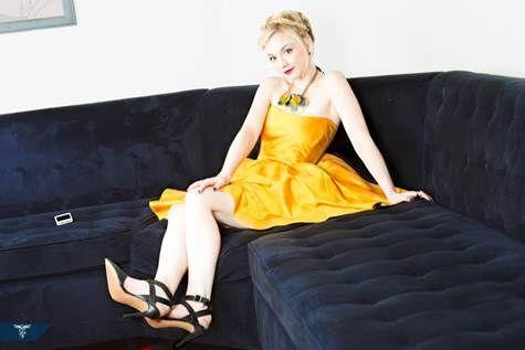File:Emily cute yellow dress in sofa.JPG