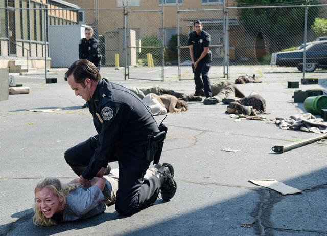 File:Officers arrest beth.jpg