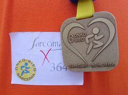 Onkobieg 2015 (medal i numer startowy).jpg