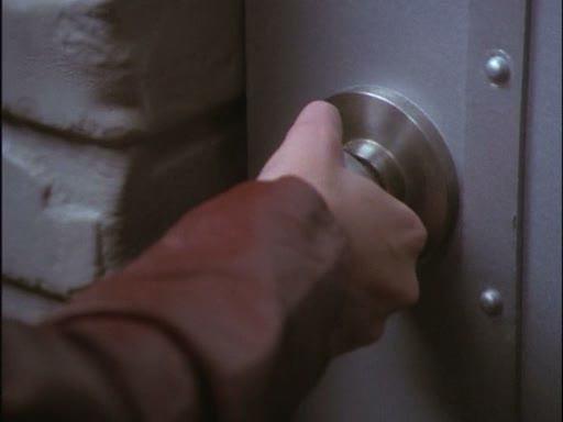 File:Phoebe gets a prmonition from stefan's door handle.jpg