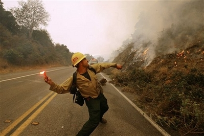 File:FirefighterThrowingFlare.jpg