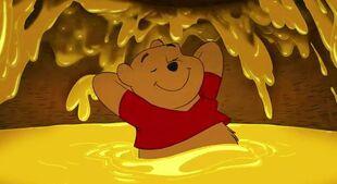 Pooh relaxing in honey pot