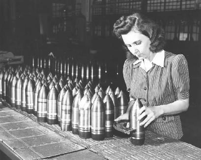 File:American factory worker prepares munitions, unknown date.jpeg