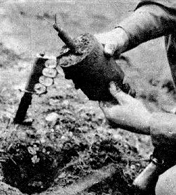 File:American paratrooper disarming an S-Mine.jpg