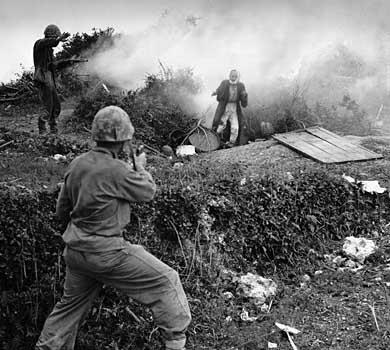 File:Okinawan civilian fleeing a smoked out cave, Okinawa 1945.jpg
