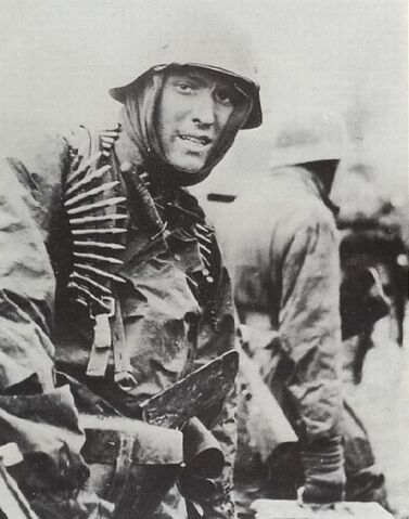 File:German soldier with MG belts, Ardennes 1944.jpg