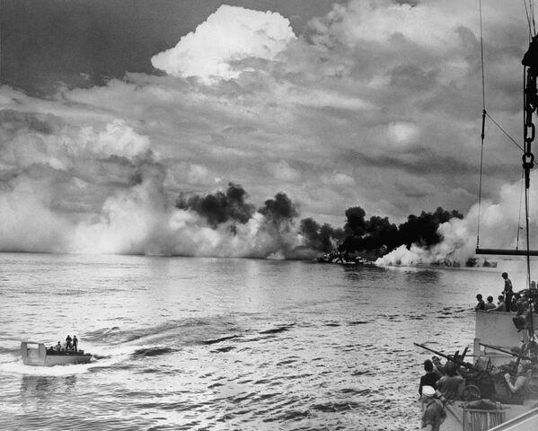 File:Ship burning in the distance, Samar 1944.jpg