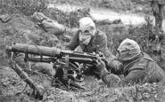 800px-Vickers machine gun crew with gas masks