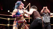 Asuka fighting Nikki-Cross