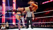 Becky drop kicking sasha