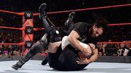 Seth-Rollins attacking Joe