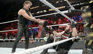 Chris Jericho-hands-title-to-Kevin Owens