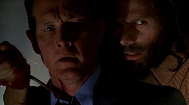 File:John Doggett is taken hostage by Robert Fassl.jpg