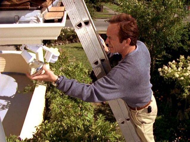 File:Frank Black installs security light.jpg