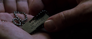 Magneto inspects Wolverine's Dog Tag (X-Men - 2000)