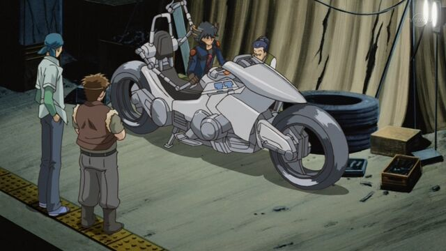 File:Yusei and co work on first Duel Runner.jpg