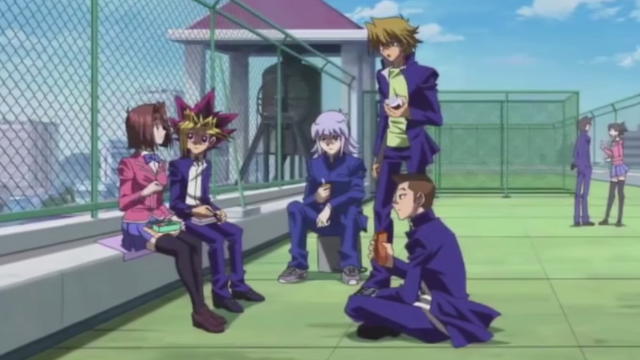 File:Yugi and friends discuss their futures.png