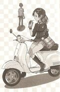 Mikoko on her Vespa, with I