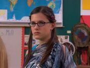 Quinn gives Logan a death glare.
